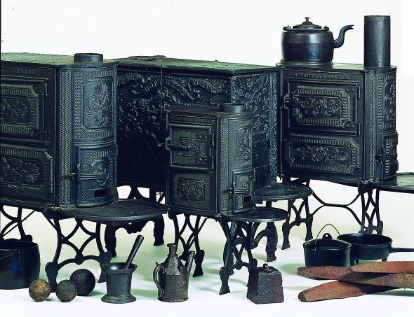 Color image of finished products: stoves, irons, tea kettles.