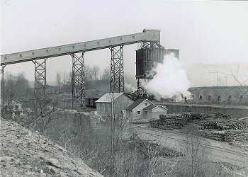 A view of the Shoaf coal and coke plant. A large stock of mine timbers is stored on the complex in the foreground.