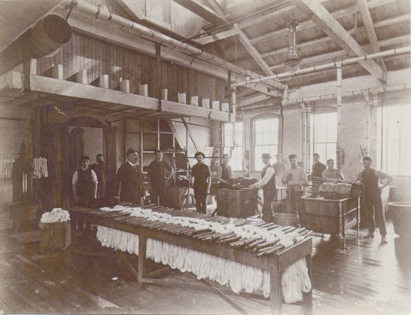 Image of men working inside the factory.