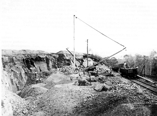 Image of the quarry and workers.