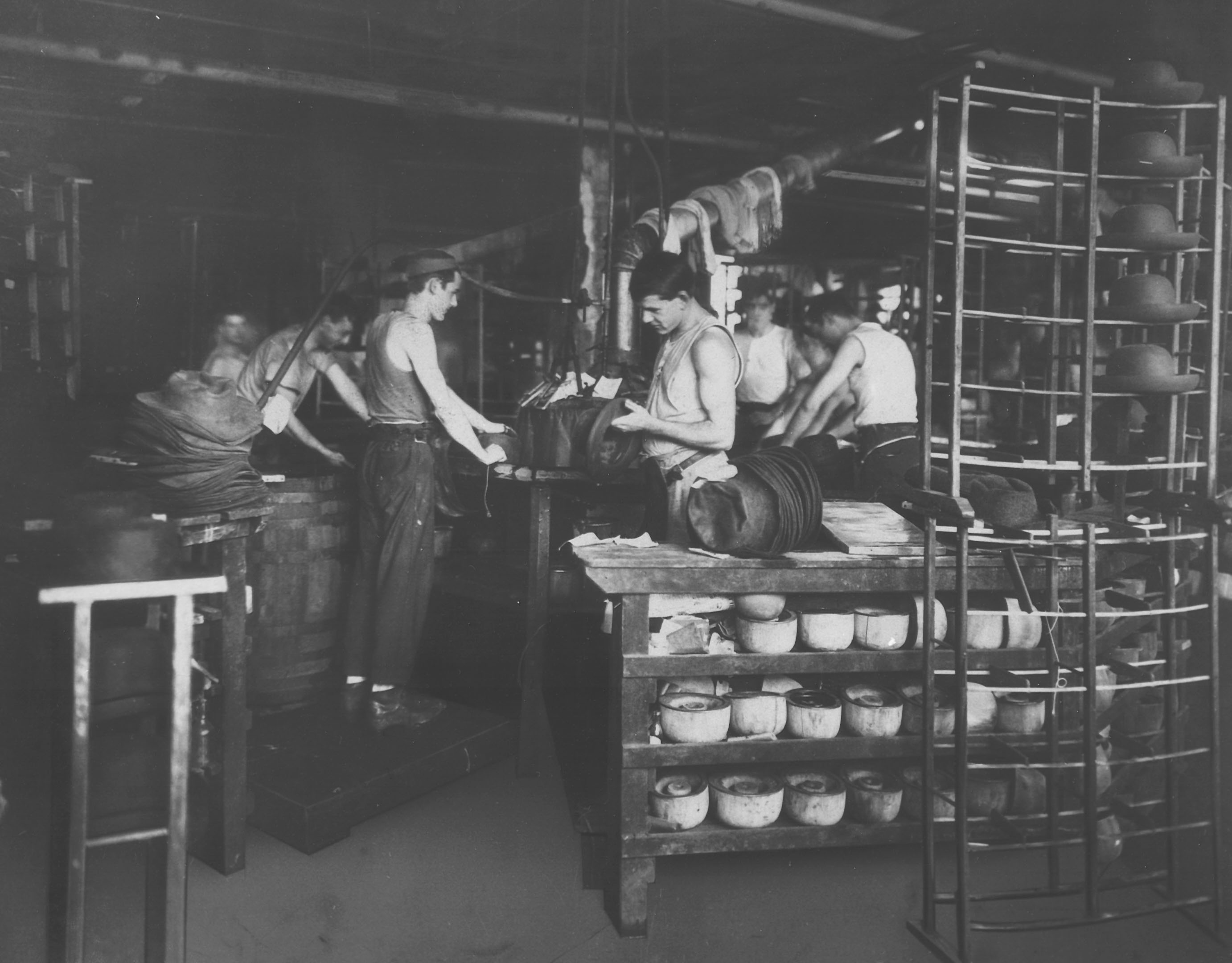 80bafc418e443 Workers finishing hats in the Sterson factory.