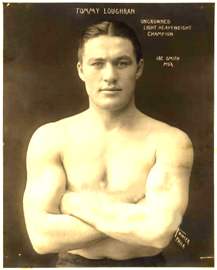Head and shoulders of a boxer, with his arms crossed.