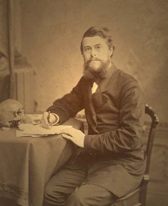 Edward Drinker Cope sits a desk.