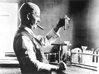 Edward Goodrich Acheson in the lab with his omnipresent cigar, testing Aquadag, a colloidal suspension of his artificial graphite.