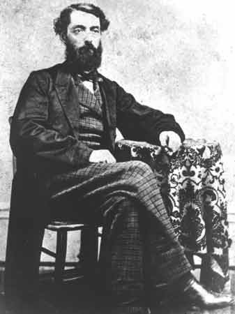 A portrait of a seated Edwin L. Drake in formal clothes.