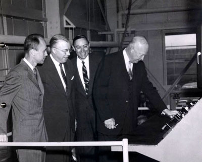 Professor of nuclear engineering William Breazeale, Penn State president Milton S. Eisenhower, dean of engineering Eric Walker, and U.S. President Dwight D. Eisenhower at the dedication ceremony for the research reactor, February 22, 1955.