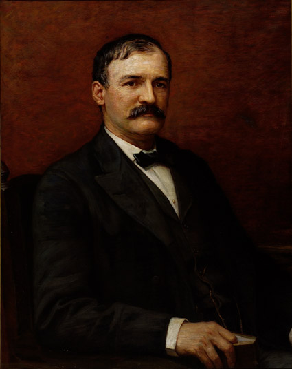 Oil on canvas of Pattison seated, wearing a suit.