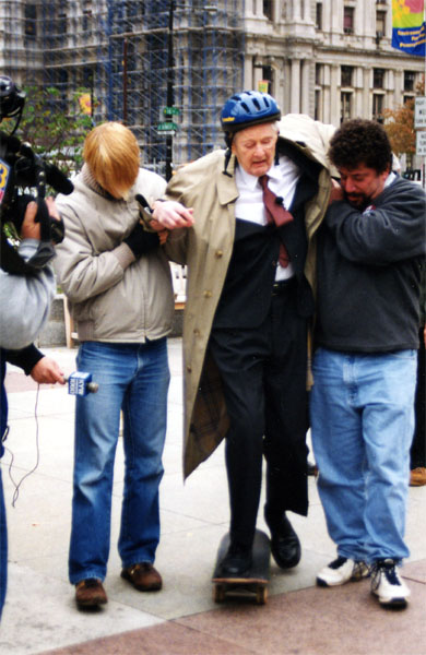 Edmund Bacon, age 92, skateboards while staging a protest about the changes to LOVE Park, with assistance from City Paper editorial design director Brian Hogan and executive editor Howard Altman, October 28, 2002.