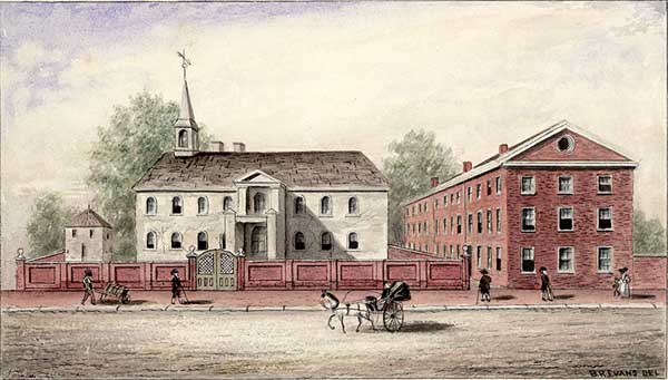 The Old Academy, enclosed by a high red brick wall, is a 2 1/2-storey gray building with a small steeple sporting a weathervane. The wall also encloses a smaller gray building to the left. To the right is a 3 1/2-storey red brick building(or three row buildings), not identified, facing on the alley adjacent to the wall. Three men in stockings, britches and tricorn hats pass by. A woman and child are also visible. An African-American man to the left pushes a loaded wheelbarrow. A horse and carriage with folded hood pass by. The trees are in full leaf.