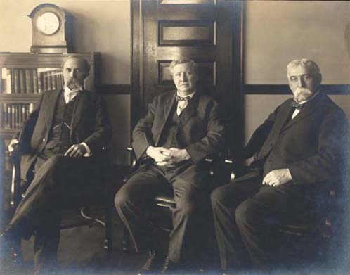William B. Wilson, (center) sitting with Terence V. Powderly to his left and Commissioner-General of Immigration Anthony Caminetti on his right, 1915.