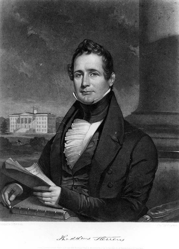 Black and white image of a portrait of Stevens seated, holding a book.