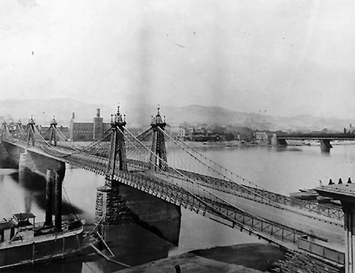 The Pittsburgh-Allegheny Bridge, ( the site of today's Smithfield Street Bridge), built by John Roebling in 1846.
