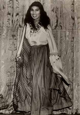 Marian Anderson in costume in front of a curtain on stage.