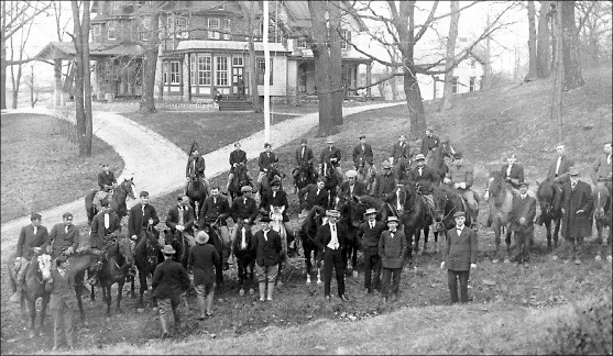 In the foreground are students on horses and Wiestling Hall is featured in the background of the photo