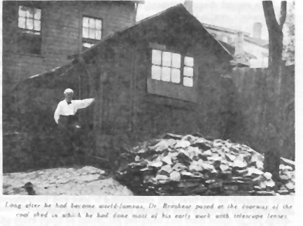 John Brashear, standing next to the coal shed where he first began work on telescope lens in the early 1870s, Pittsburgh, PA, 1913.