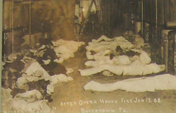 Interior ruins and wrapped bodies of the dead at the Boyertown Opera House, January 13, 1908.