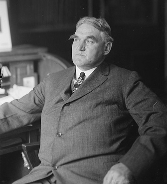 Photograph of Pennsylvania Governor Martin Brumbaugh sitting in a chair, circa 1915