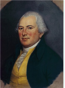 Formal color portrait of Thomas Mifflin wearing a dark suit with a yellow vest and ruffled shirt.