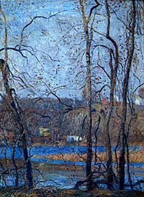 A Pennsylvania river scene viewed through the barren trees of winter.