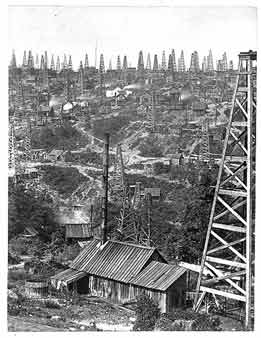 A lack of knowledge about geology led oil prospectors to drill wells virtually anywhere, and to drill many wells at a productive site. Triumph Hill, near Tidioute, Warren County, boasted the highest density of wells in the oil region. Fifty derricks can be seen in this view.