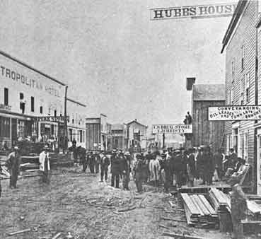 Pithole City was typical of many towns that sprang up and as quickly died around oil sites. Within six months of the discovery of oil in 1865, Pithole's population exploded from zero to 15,000. Here, construction along the main street during the boom is shown.