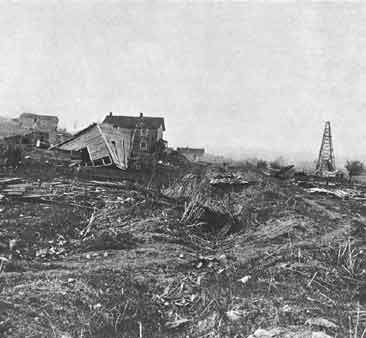 By 1870 Pithole was all but deserted, and most buildings were sold for scrap or abandoned. This view shows what was left of the town in 1883. Today, all that remains of the boomtown are cellar holes where buildings used to be.