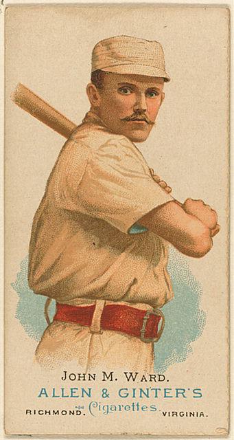 Baseball card of  John M. Ward holding a bat.