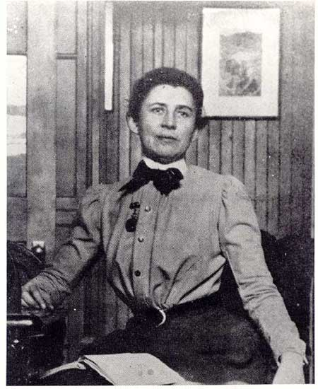 A woman seated.