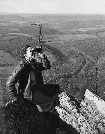 Rachel Carson, shown here on Hawk Mountain, Pennsylvania, helped launch the modern environmental movement with her book, Silent Spring.