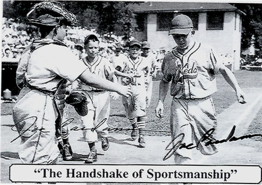 Black and white baseball card of a runner coming into home while the catcher offers his outstretched hand to congratulate the runner.