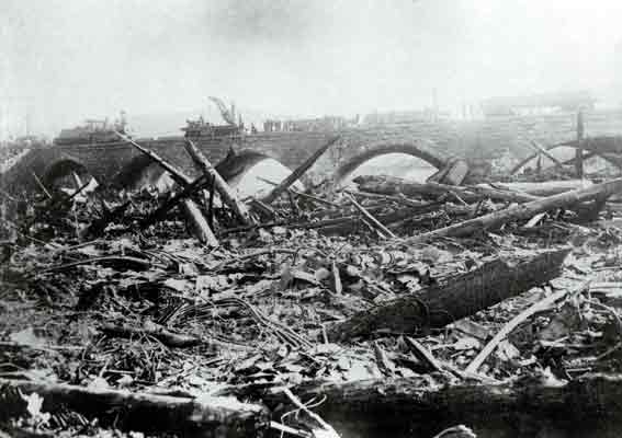 Debris from the Johnstown Flood piled up against the Pennsylvania Railroad's Stone Bridge and caught fire. More than 2000 people died in the disaster, and some were burned alive in the fire at the bridge.