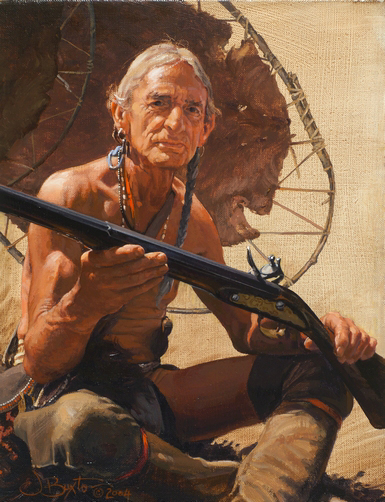 An elderly Indian man holds a rifle in his hands.