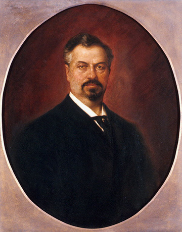 Oil on canvas of head and shoulders of Hammerstein wearing a black suit with white shirt.