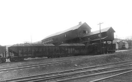 Filled coal cars and railroad tracks sit in the front of the tipple of the Cambria Smokeless Mine.