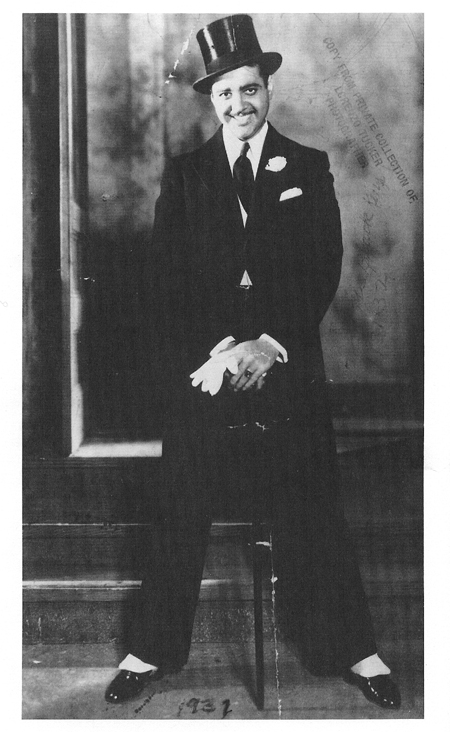 Image of Lorenzo Tucker in a tuxedo, wearing a top hat and holding a cane.