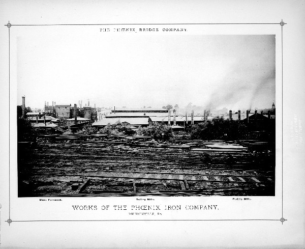 Black and white image showing railroad tracks in the foreground and different iron works buildings (blast furnaces, rolling mills, and puddle mills)  labeled in the background.
