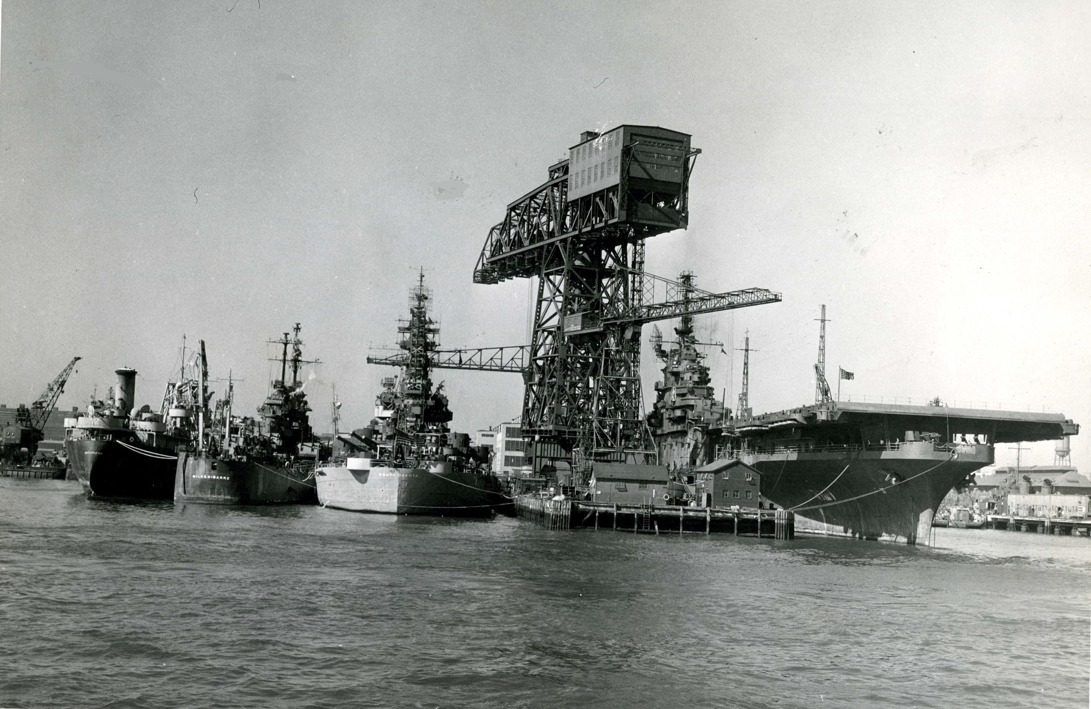 Fighting ships of the u. s. navy moored alongside its famous hammer