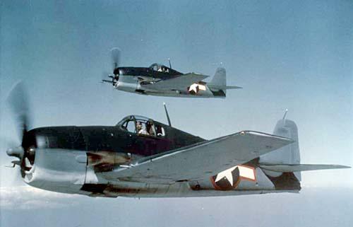 Two Grumman Hellcats in flight.